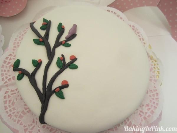 Sugar paste fondant decorations over polka dot lemon cake