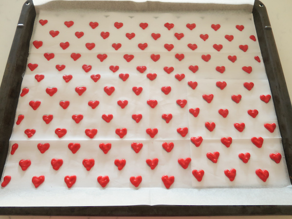heart patterned roll cakes baking in pink